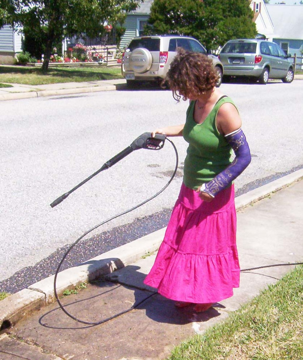 If a young lady with a broken arm can power wash the sidewalk, so can you. More powerful pressure washers need to be handled with both hands.