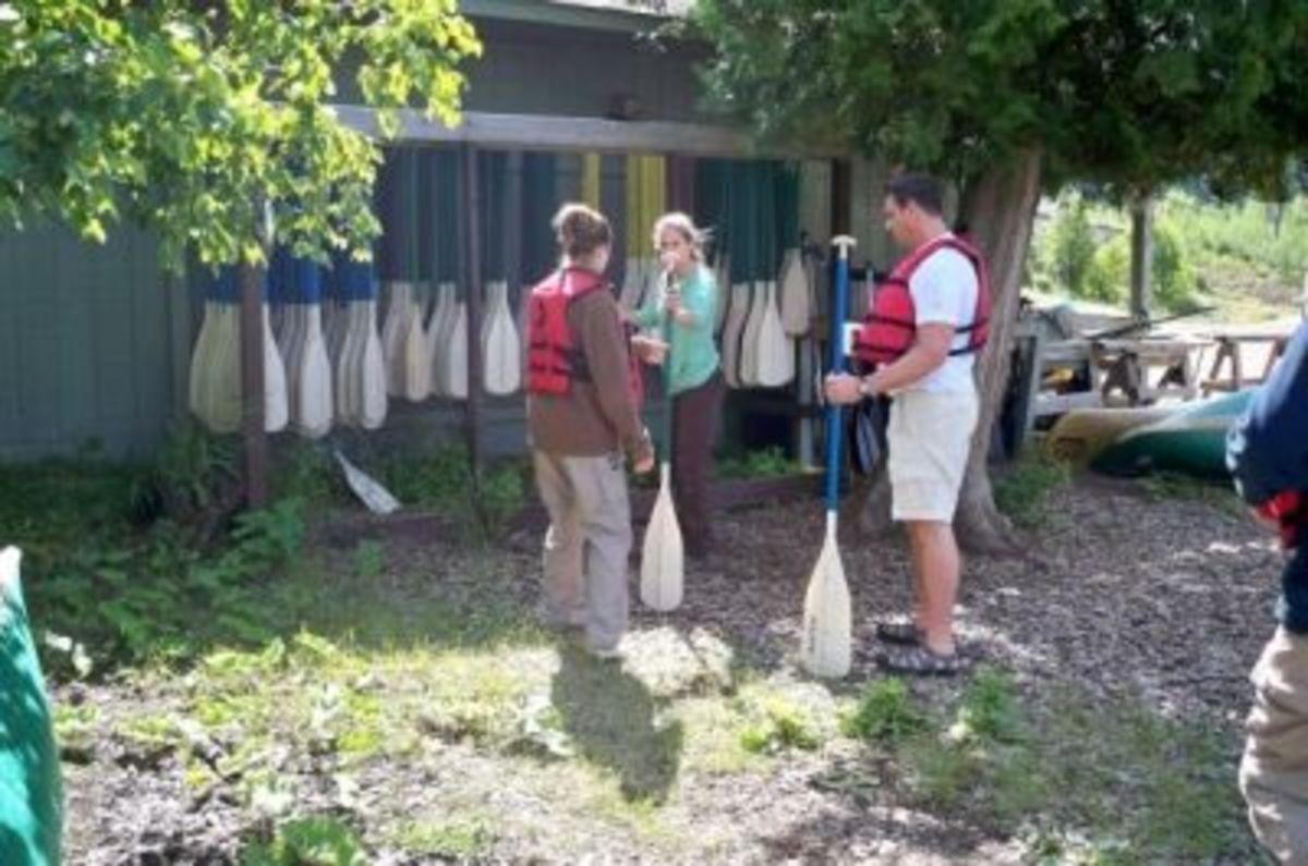 Bonnie sizes us up for canoe paddles.