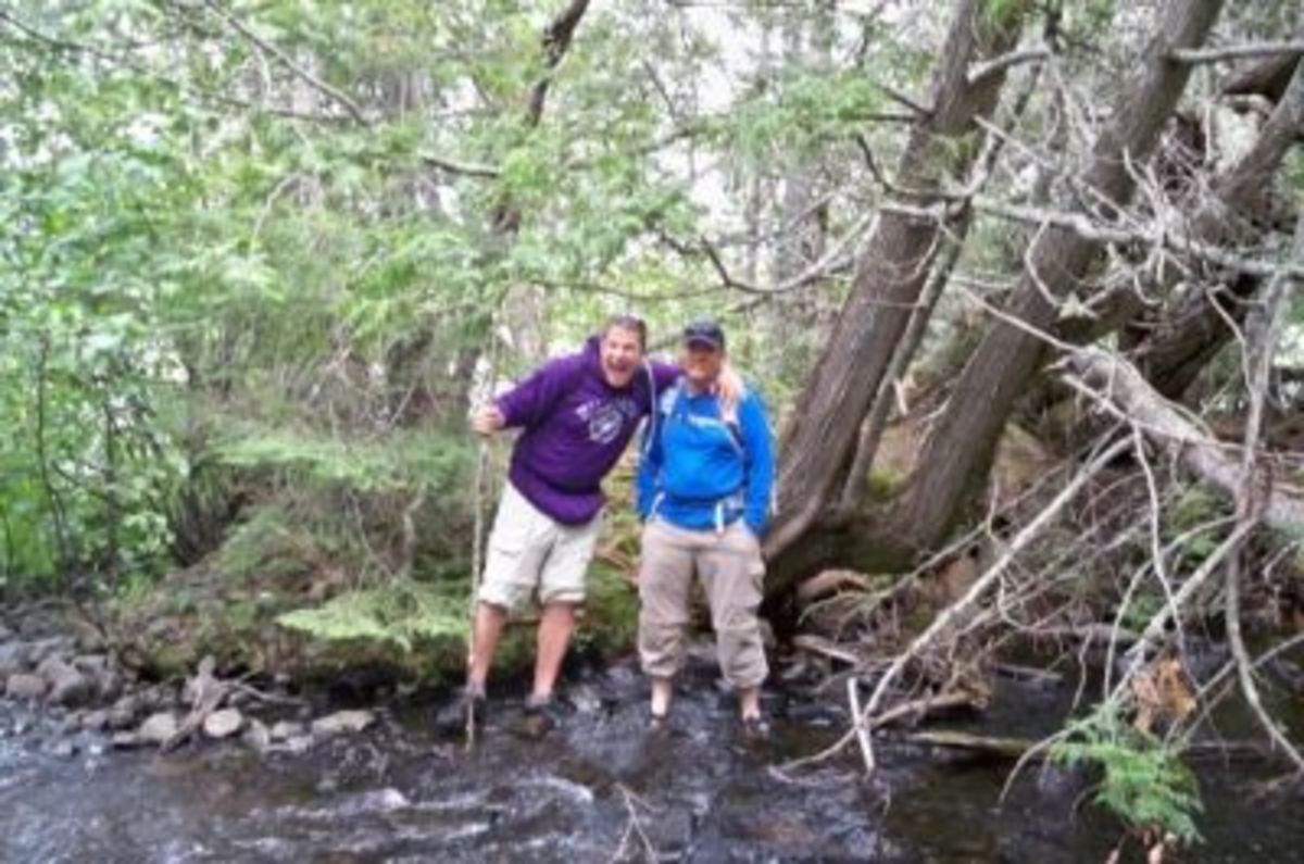 Illegal border crossers, Chris and Steve, standing on the Candian side of the creek
