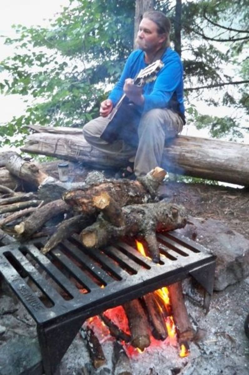 Steve plays us a tune around the campfire. You can collect wood as long as it's away from shore, dead and no longer standing.