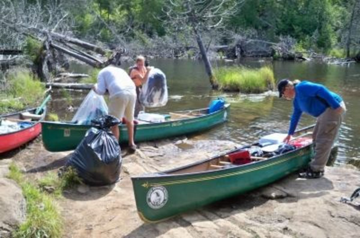 Unloading the boats for our first portage