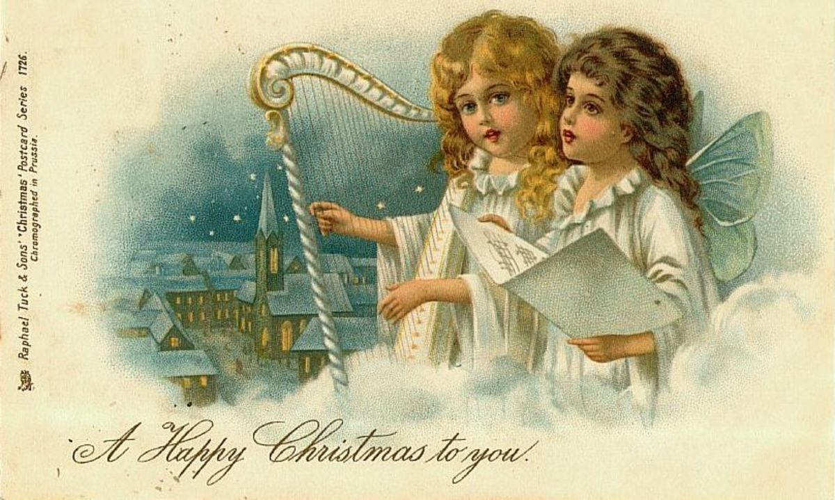 Two vintage Christmas angels floating in the clouds with harp and village in the background