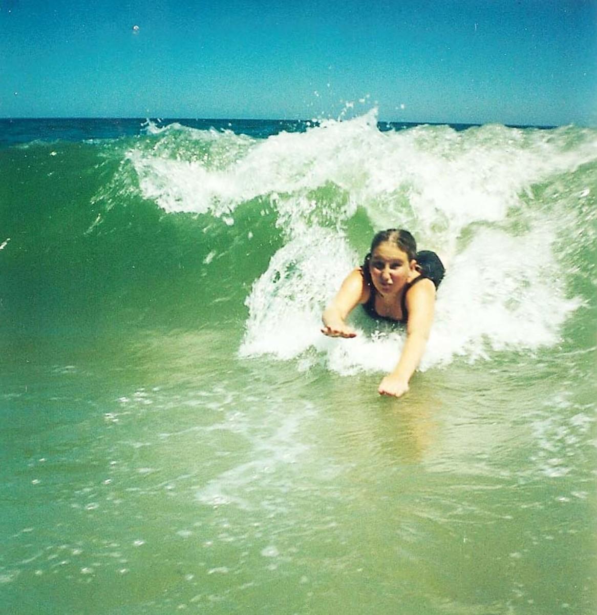 Bodysurfing - Girl in Ocean City, Maryland (phot0 by Dolores Monet)