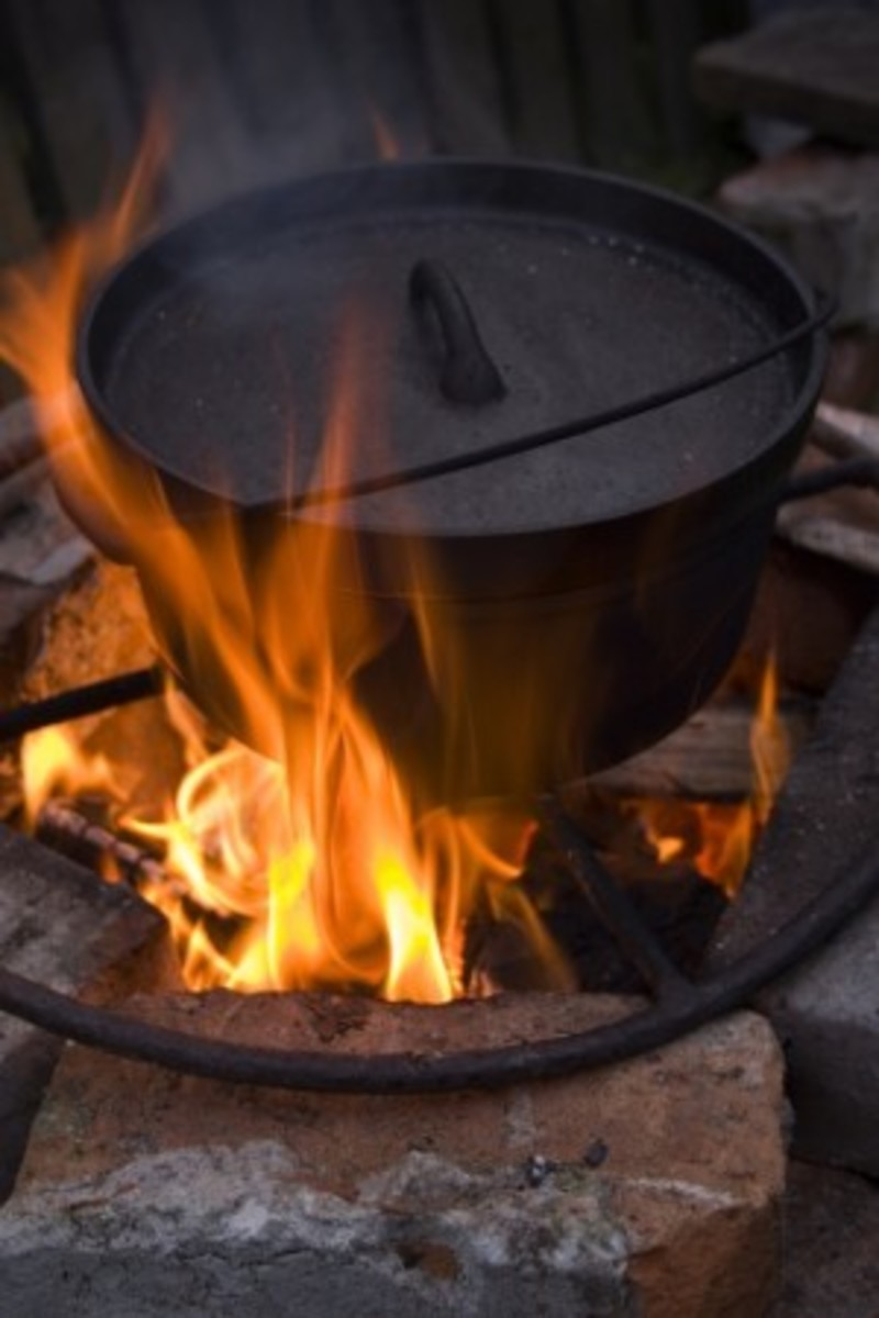Dutch oven cooking on campfire flames