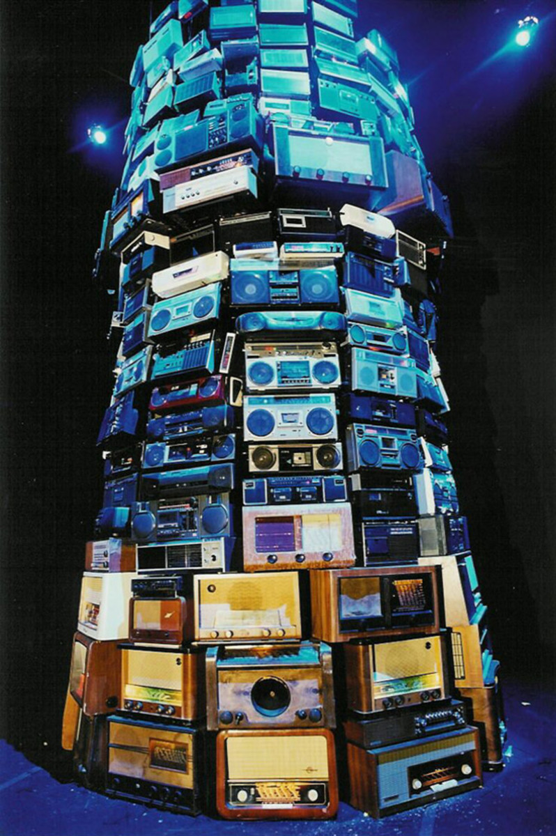 Modern Technological gadgets and apparel in a symbolic representation of the New Media technology as the Tower of Babel