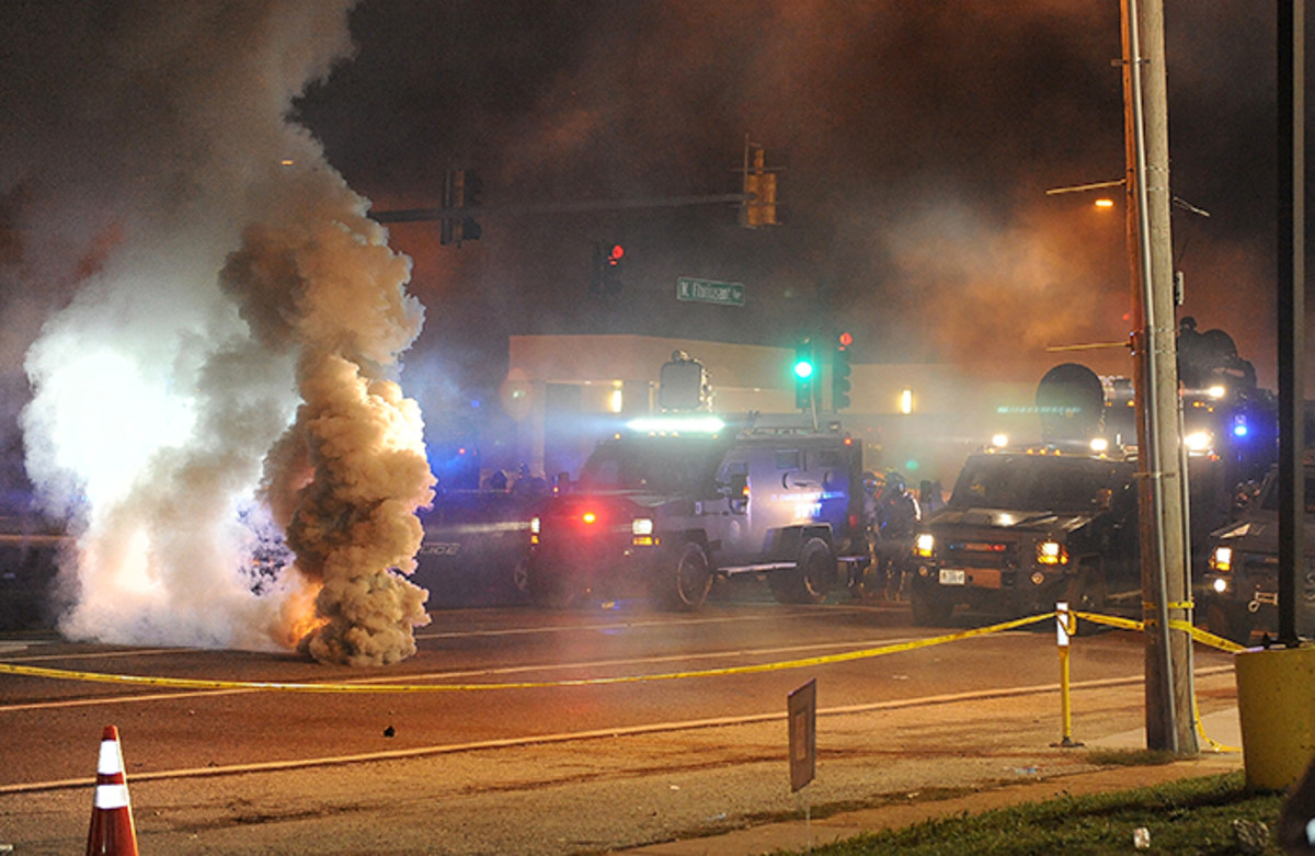 Law enforcement fires tear gas on protesters on West Florissant Road in Ferguson, Missouri on August 17, 2014. (AFP Photo / Michael B. Thomas)