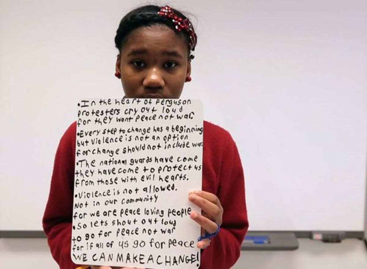 Seventh grader Tia Hudson shares her thoughts on images from the recent unrest in Ferguson on her first day back at school since the riot during Honors 7th grade English class on Tuesday, Dec. 2, 2014. Go to stltoday.com/video to listen to Hudson and