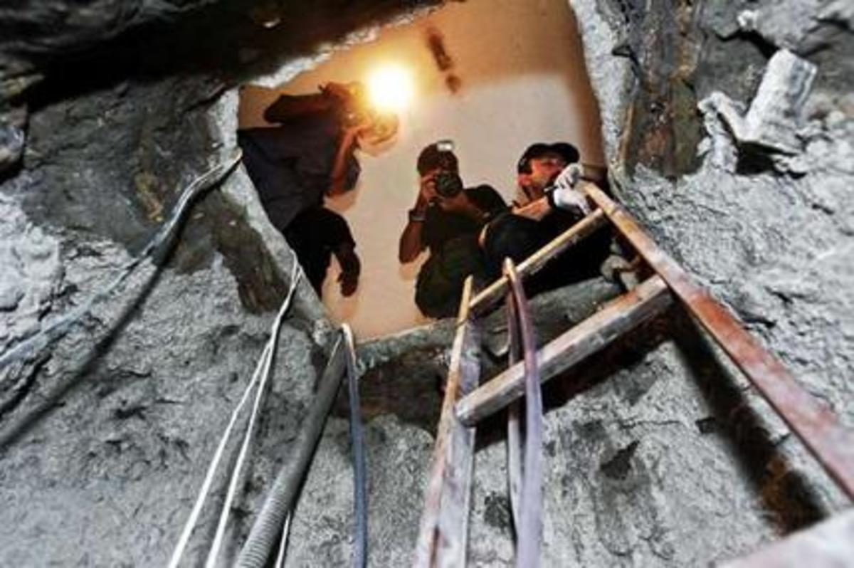 Brazilian police inspect the tunnel