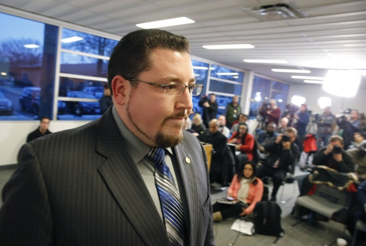 Ferguson Mayor James W. Knowles leaves a news conference after reading a statement on Wednesday.