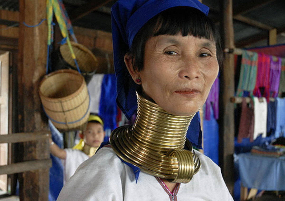 Women of the Padaung tribe use brass rings - up to 25 for an adult - to progressively stretch their necks. Rings are worn also on the calves.  Image and desciption cortesy Hoorab - Flckr