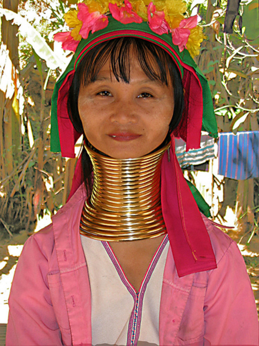"This woman from a Karen Village outside of Mae Hong Son, Thailand, has rings that weigh close to 10 pounds round her neck. The Karen tribe are refugees from Myanmar. There's an entrance fee to see the village so you are an official ""gawker"", but the"