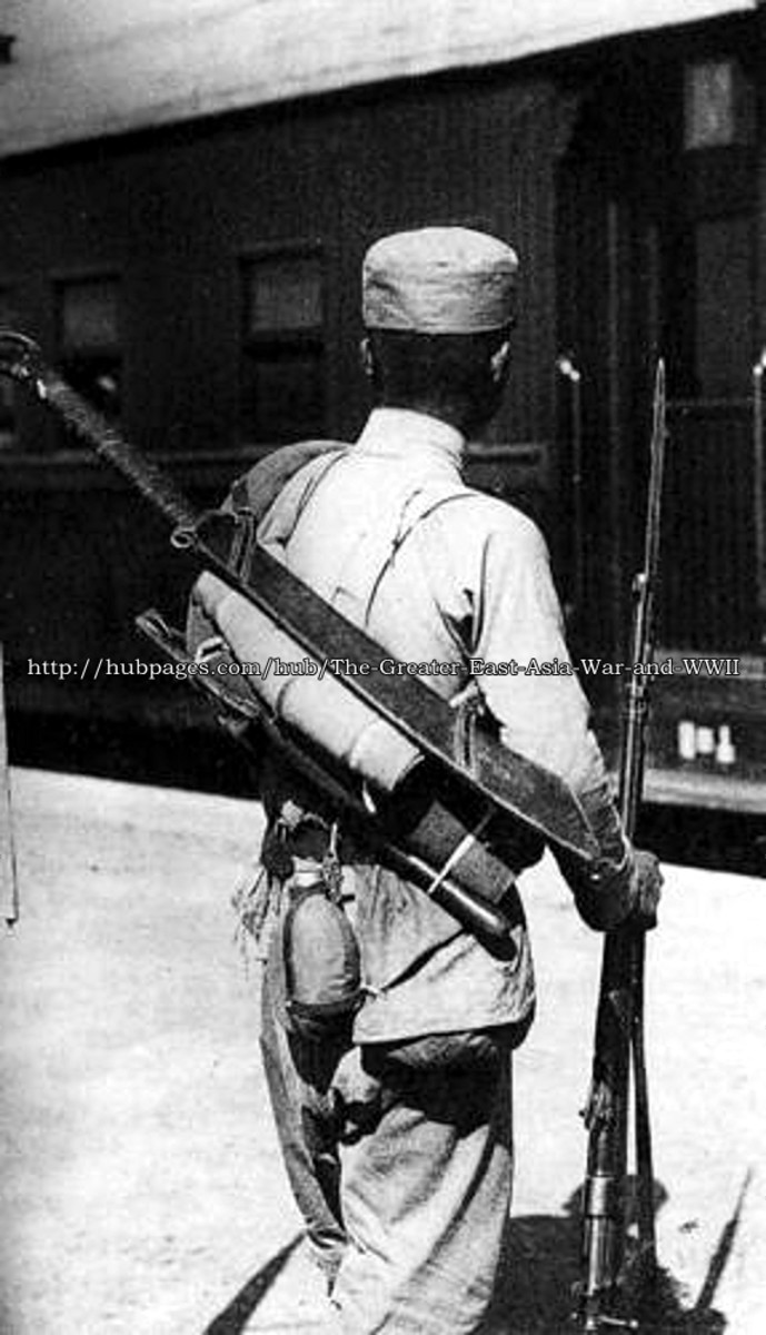 Chinese soldier armed with a sword at a train station -- China 1939