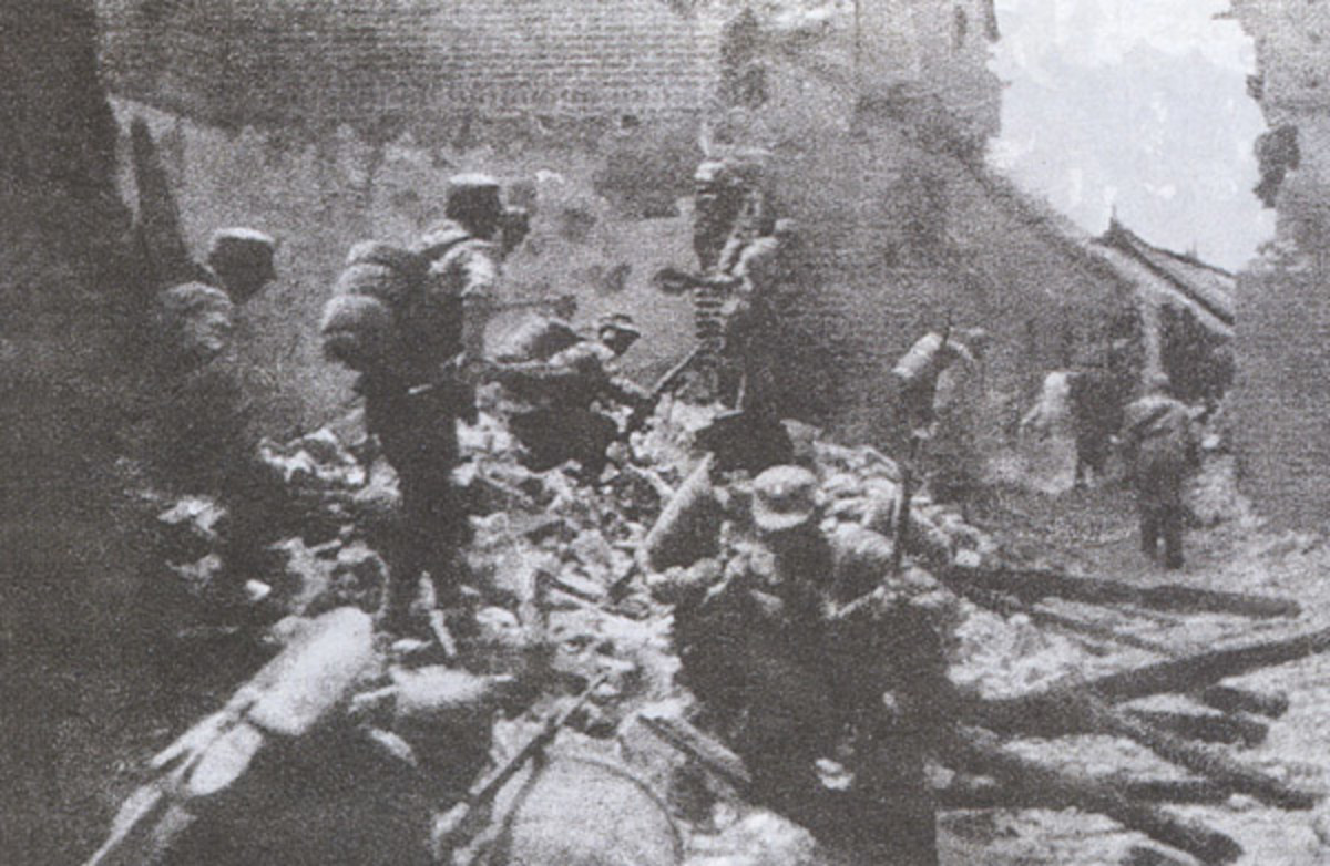 Chinese soldiers fight house-to-house in the Battle of Tai'erzhuang, March -- April 1938