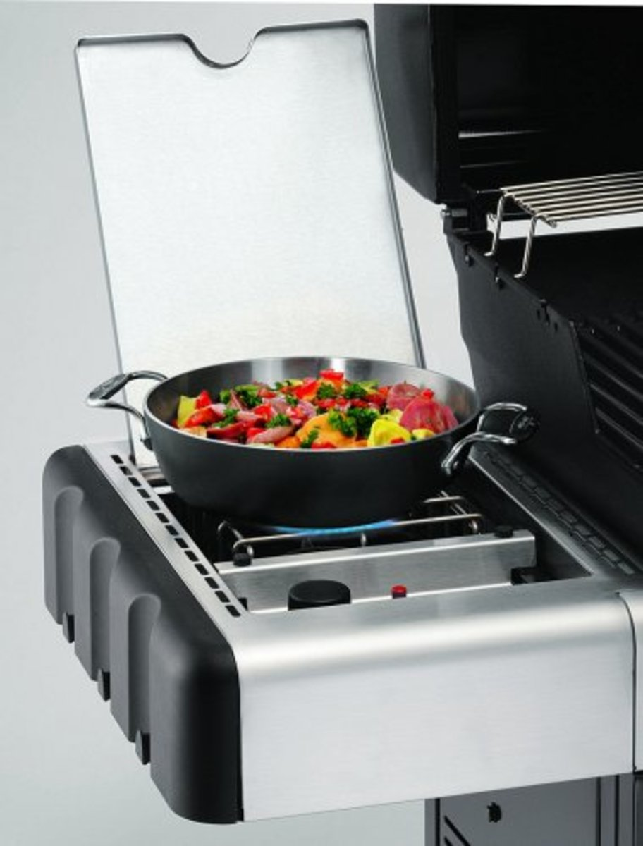 Weber recessed side burner closes to act as a side shelf for food preparation.