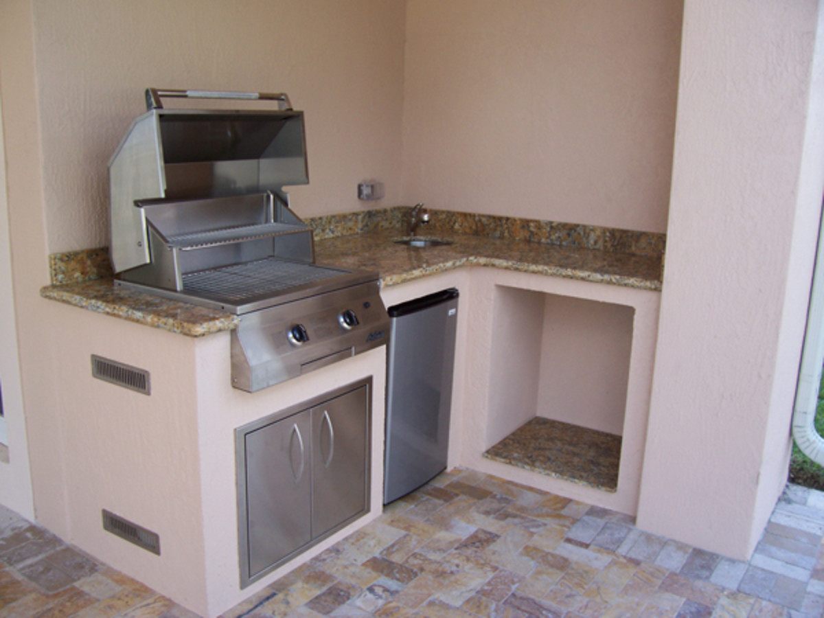 This small space is perfect for the L shape design allowing infrared grill, trash cubby, sink, and  refrigerator.