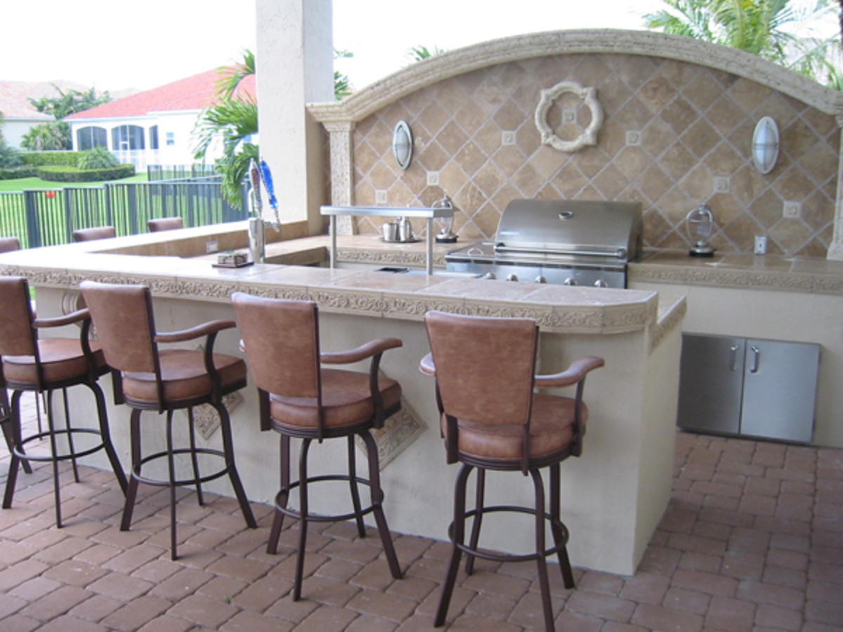 From the house to the column and into a bar.  The backsplash matches the exact arch of the roofline.