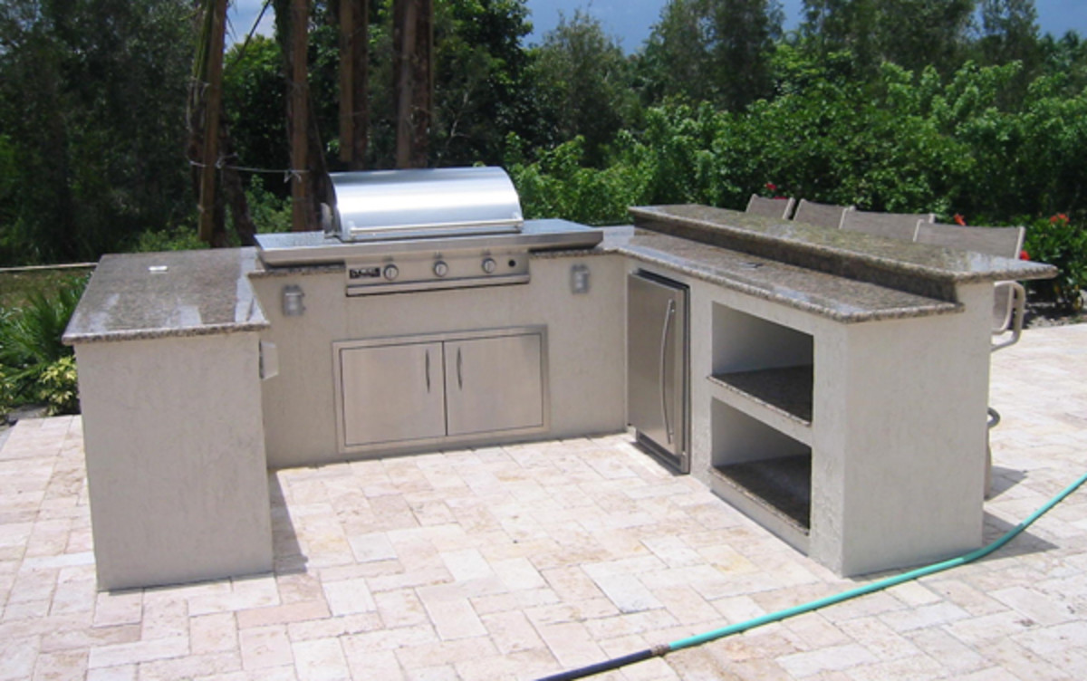 U-shaped outdoor kitchens have a lot of space to work and sit to eat or socialize.