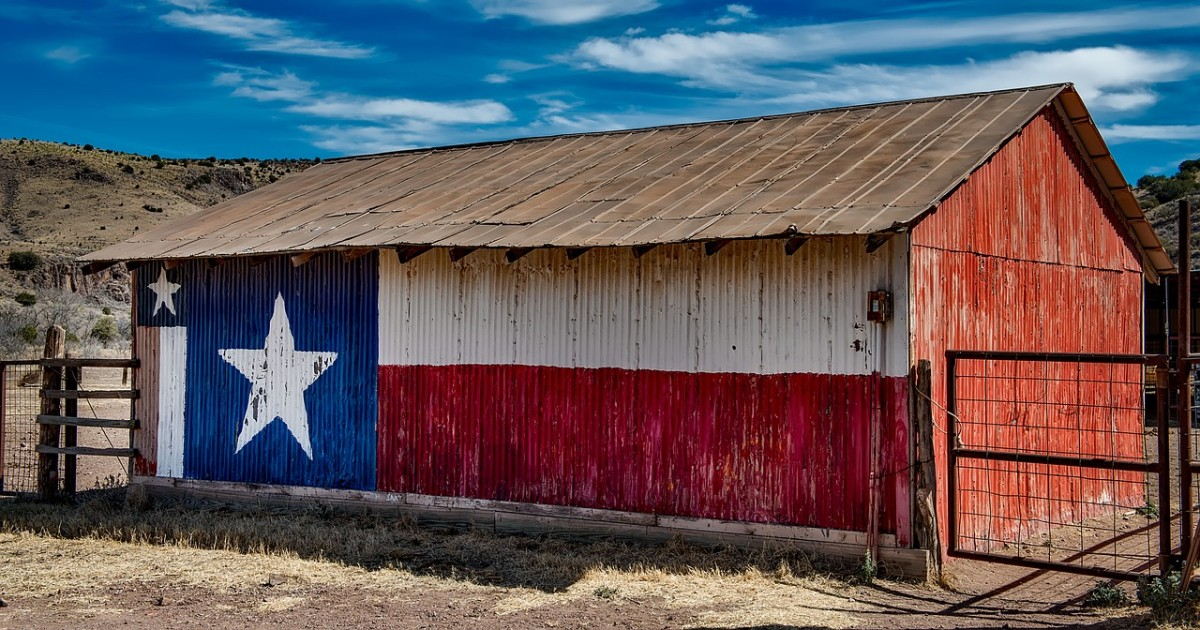 Not exactly a barn quilt, but they've created a mural with the Texas flag on this small barn.
