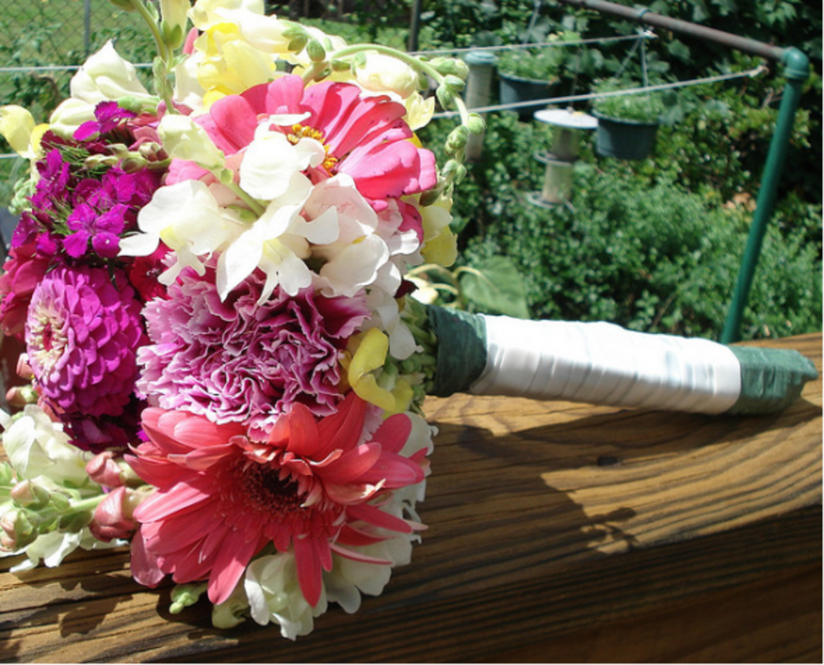 Lovely bouquet made with gerbera daisies, carnations, snapdragons and other wild flowers.