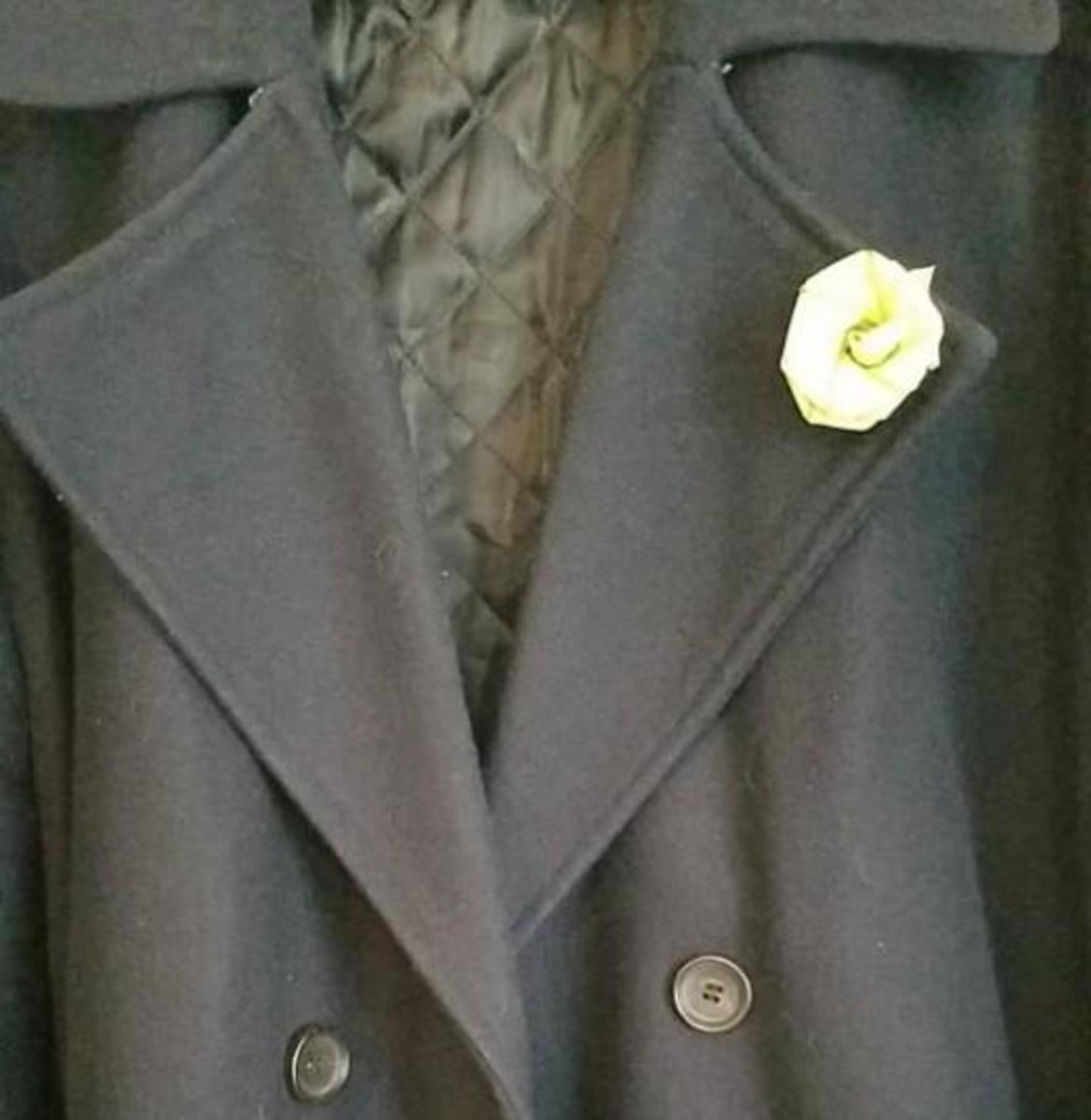 Make a small rose and push through a button hole in your jacket for a lovely palm rossette