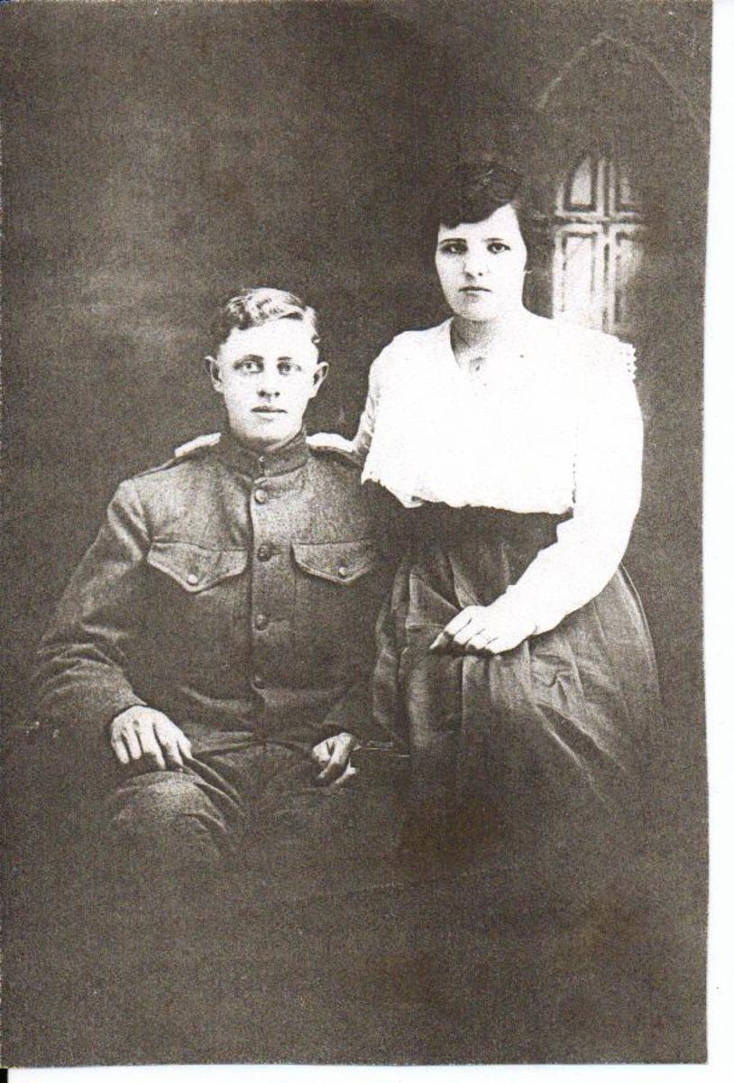 Clarence McGhee and his bride, Ruth Vining. These are my maternal grandparents and their wedding photo before he left for France in World War I.