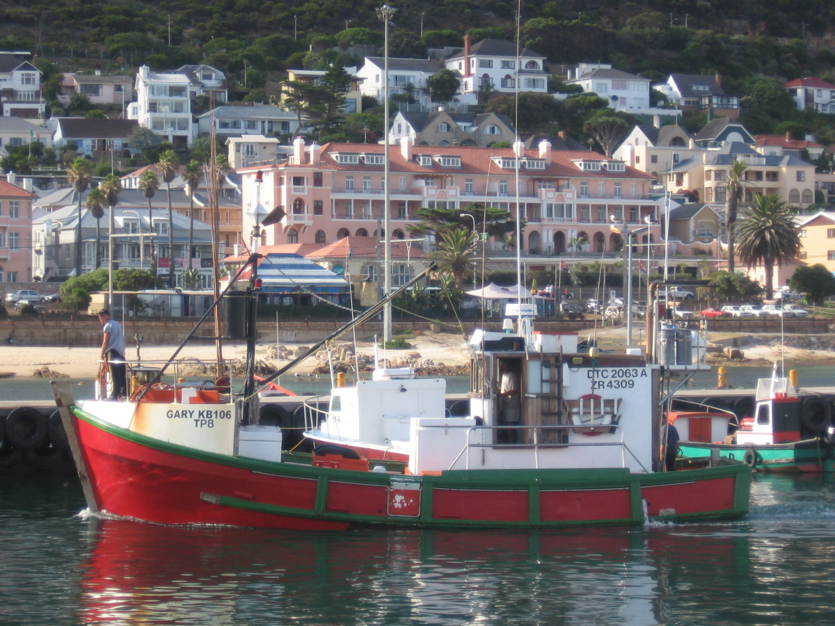 A fishing boat getting ready to dock