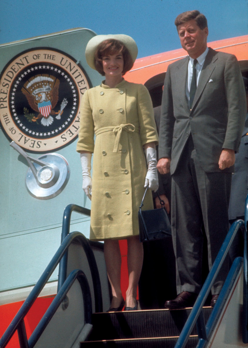 Jackie Kennedy Wearing Gloves in Business Formal Attire Standing with her husband John F Kennedy