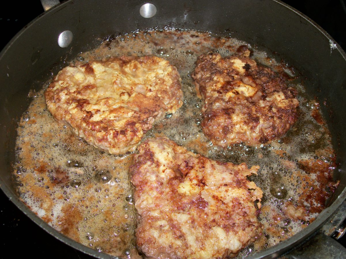 "Fry battered cubed steak in about 1/2"" of hot oil"