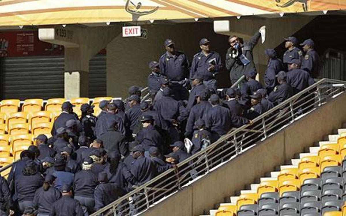 Taking control: Police in South Africa say they have taken permanent control of security at four World Cup stadiums