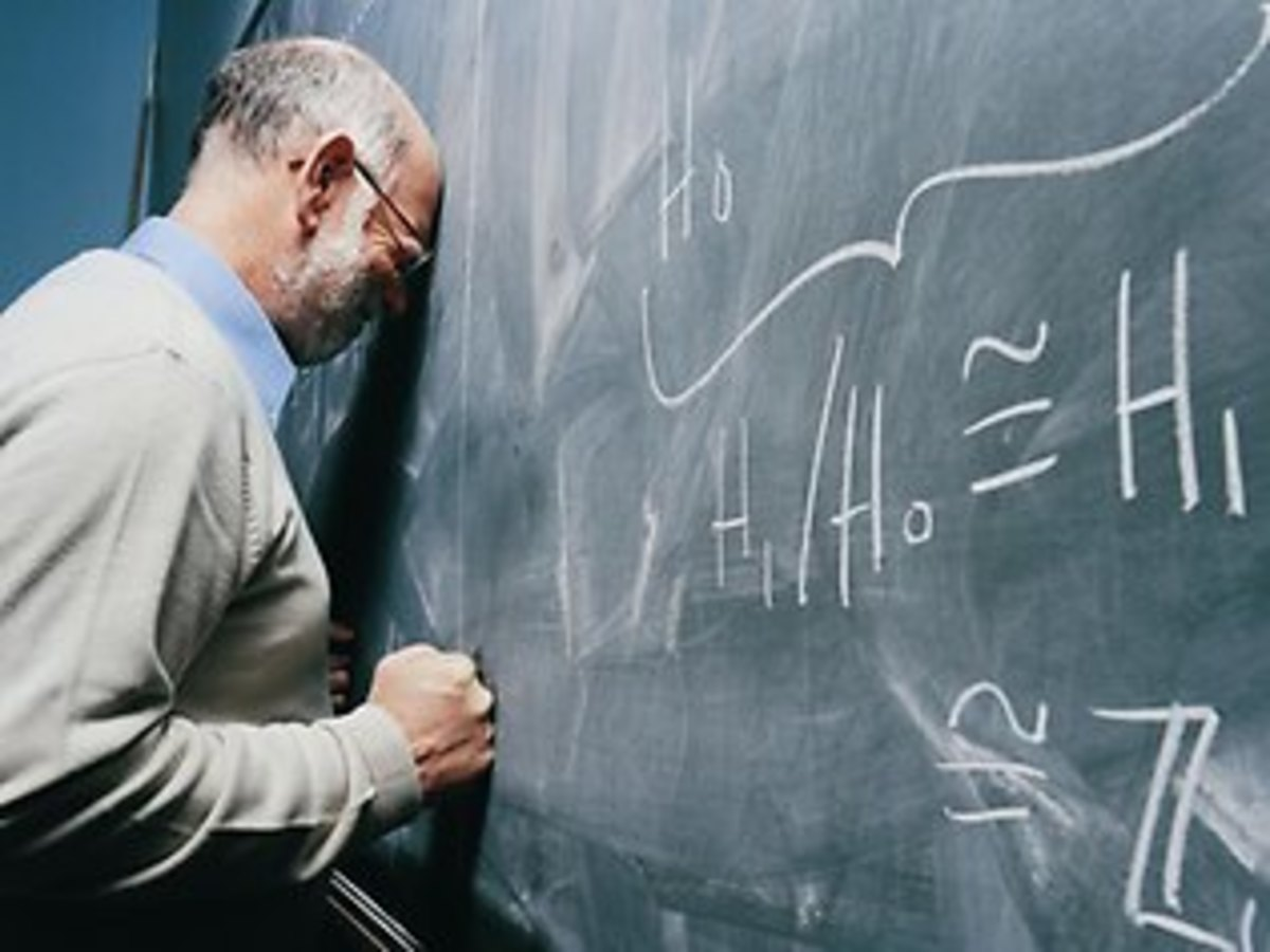 A frustrated teacher slams his head on the Blackboard, in South Africa
