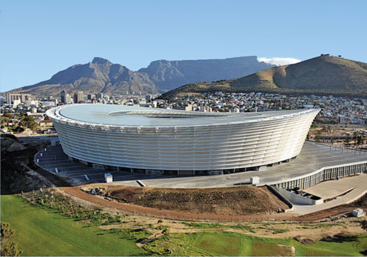 This subtle but attractive stadium is less a statement of its own than an exclamation point for a city with more than its share of iconic scenery. Positioned near the tip of Africa, Cape Town boasts an incredibly scenic oceanfront. And with Table Mou