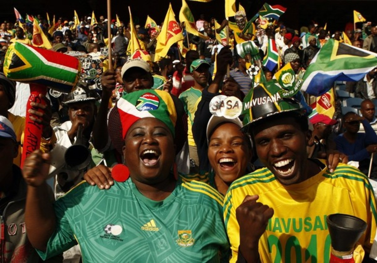 South African Fans mixed with other fans eating the World Cup fun