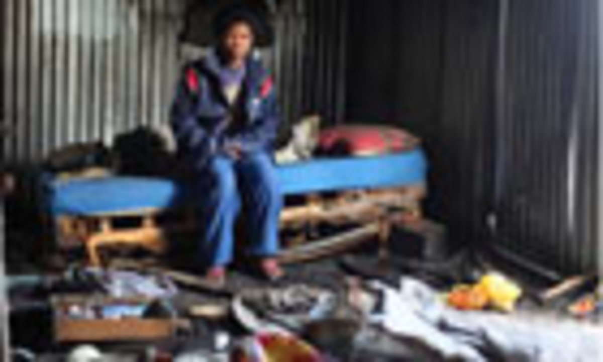 A picture of an evicted and hidden person in today's World Cup living in a Tin Shack tenement