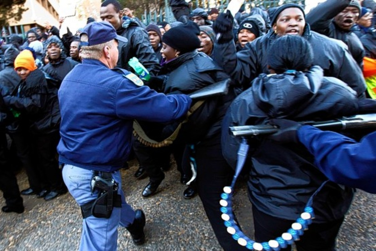 Riot police attempting mob control tactics when they were trying to break-up the Sucurty Guards strike outside Ellis Park