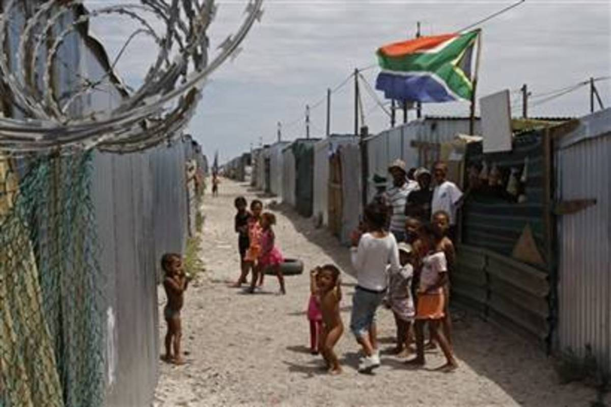 Children play in Blikkiesdorp, situated on the outskirts of Cape Town, south Africa. These people were targeted as the government tries to clean-up its image
