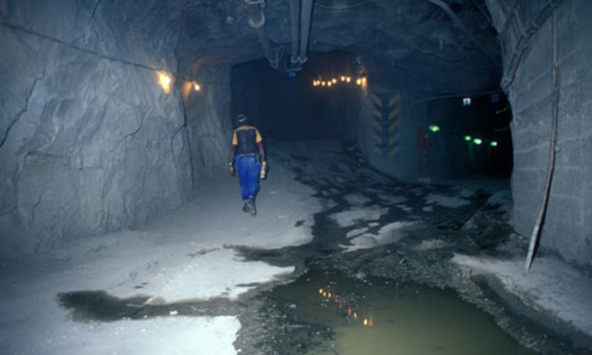An employee walk through a mine in South Africa. Conflict at Lonmin's platinum mine may put nationalization on the ANC's agenda (by Johan van Tonder)