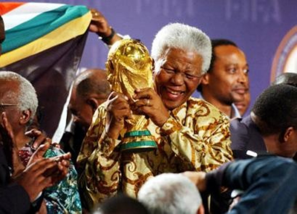 Nelson Mandela Hoisting the World Cup after South Africa was given the right to host the Finals