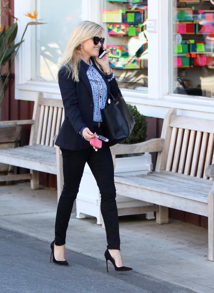 Rese Witherspoon in tight denim and sky high stilettos