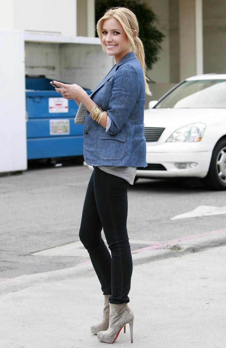 Kristen Cavallari in dark wash skinny jeans and high heel booties
