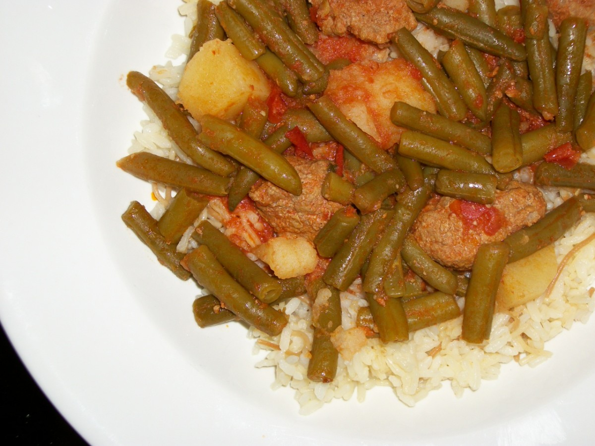Green beans with potatoes, tomatoes, and meat footballs.  Personal photo.