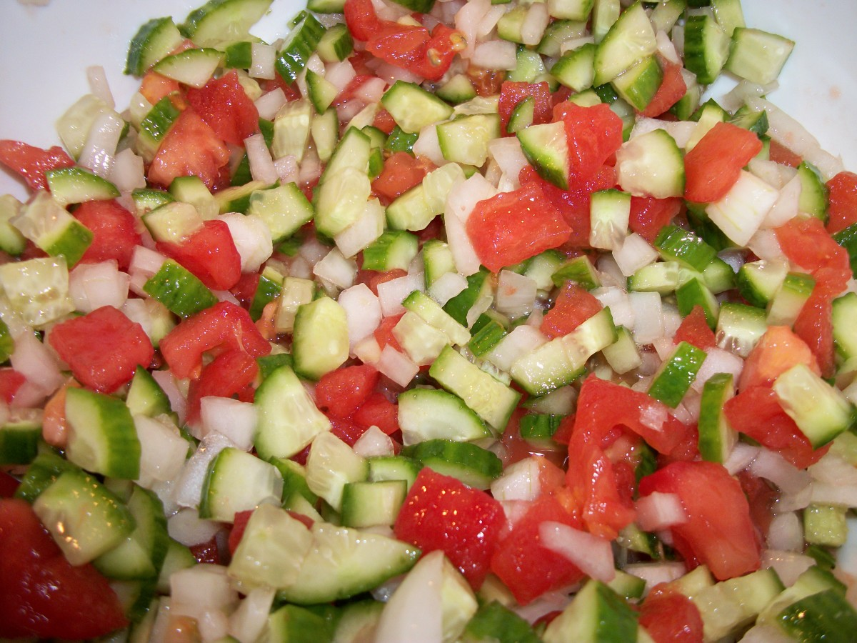 Chopped tomatoes, onions, and cucumbers. Add olive oil, lemon juice, and garlic for Coban Salad.  Personal Photo.