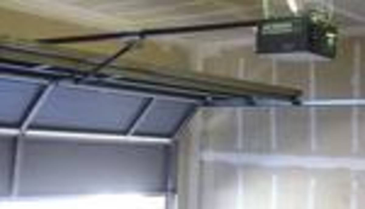 Sample Overhead Garage Door Mechanism photo courtesy of mesagaragedoors.com