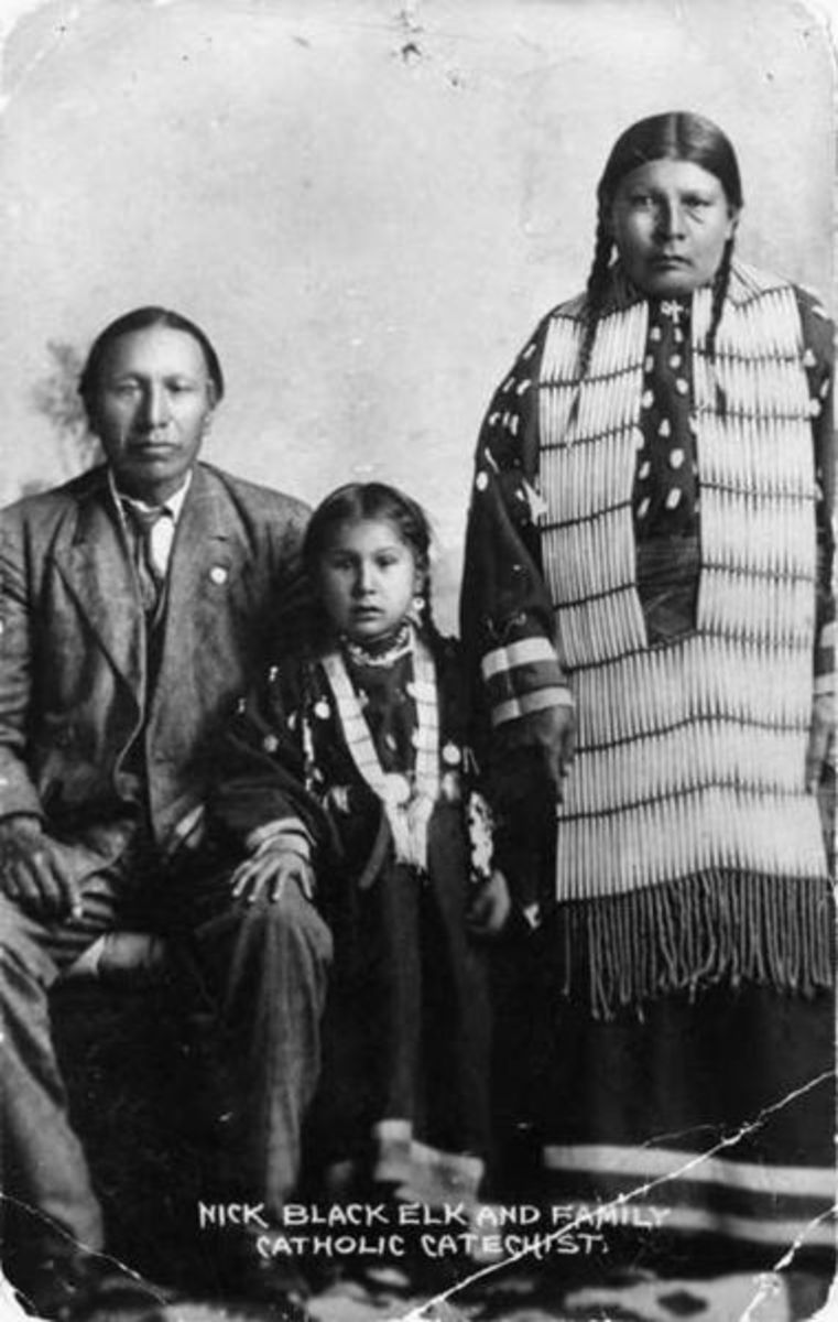 Black Elk, daughter Lucy Black Elk and wife Anna Brings White photographed in their home in Manderson, South Dakota, about 1910