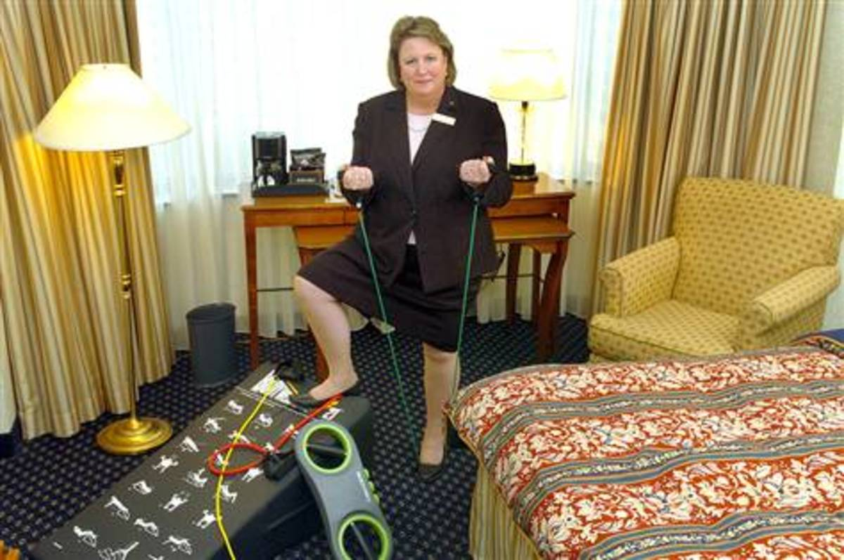 News Reporter Showcasing Resistance Bands and How They Fit Well in the Hotel Room