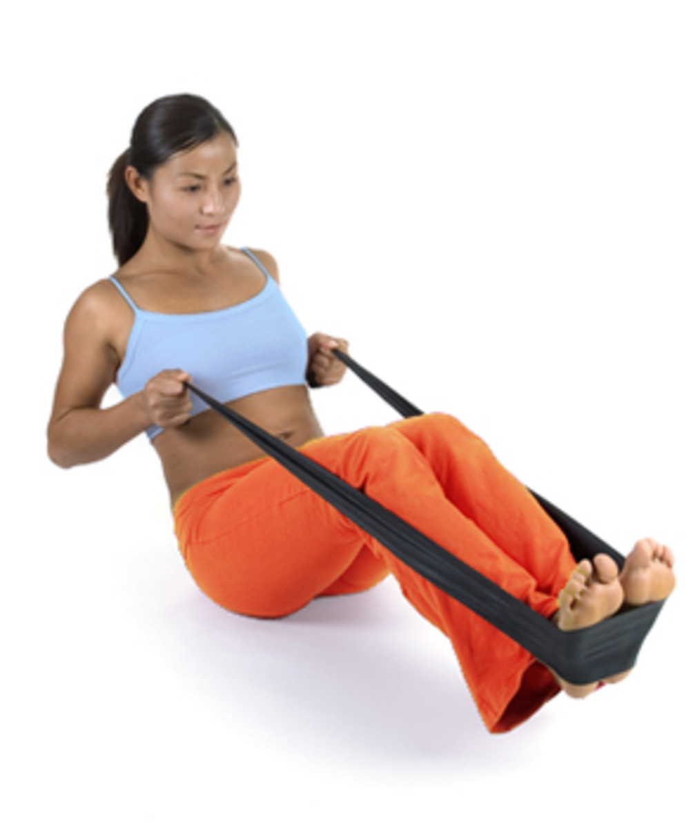 Lying on the floor for exercise with the resistance band or the rubberized tubing