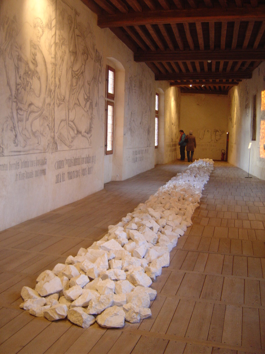 Line b Richard Long in the room that houses the fresoes of the trials of Herculese