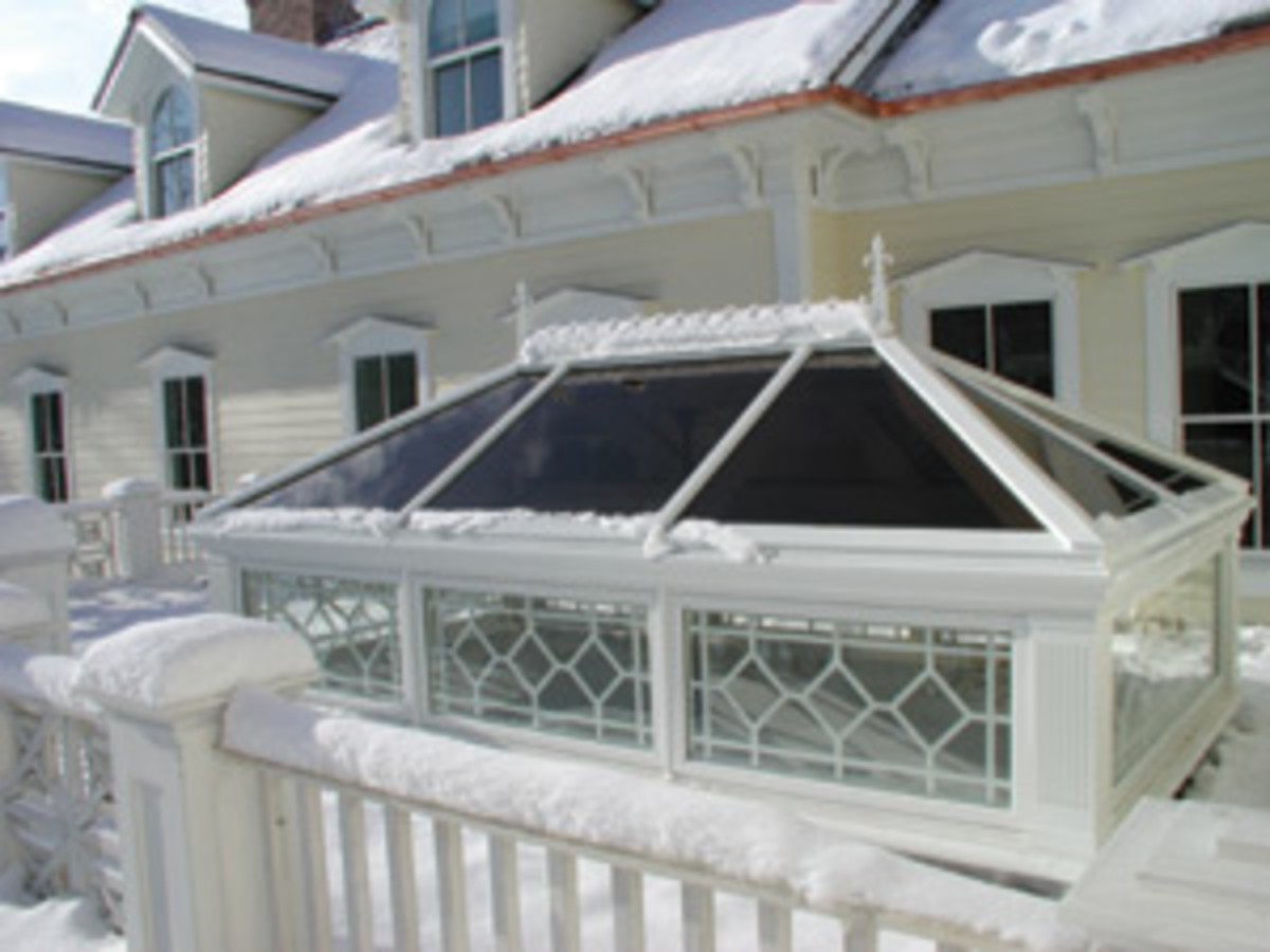 elegant Renaissance Conservatories roof lantern also features the latest high-performance glass, ensuring that the wintry cold stays outside where it belongs. Photo: courtesy of Renaissance Conservatories