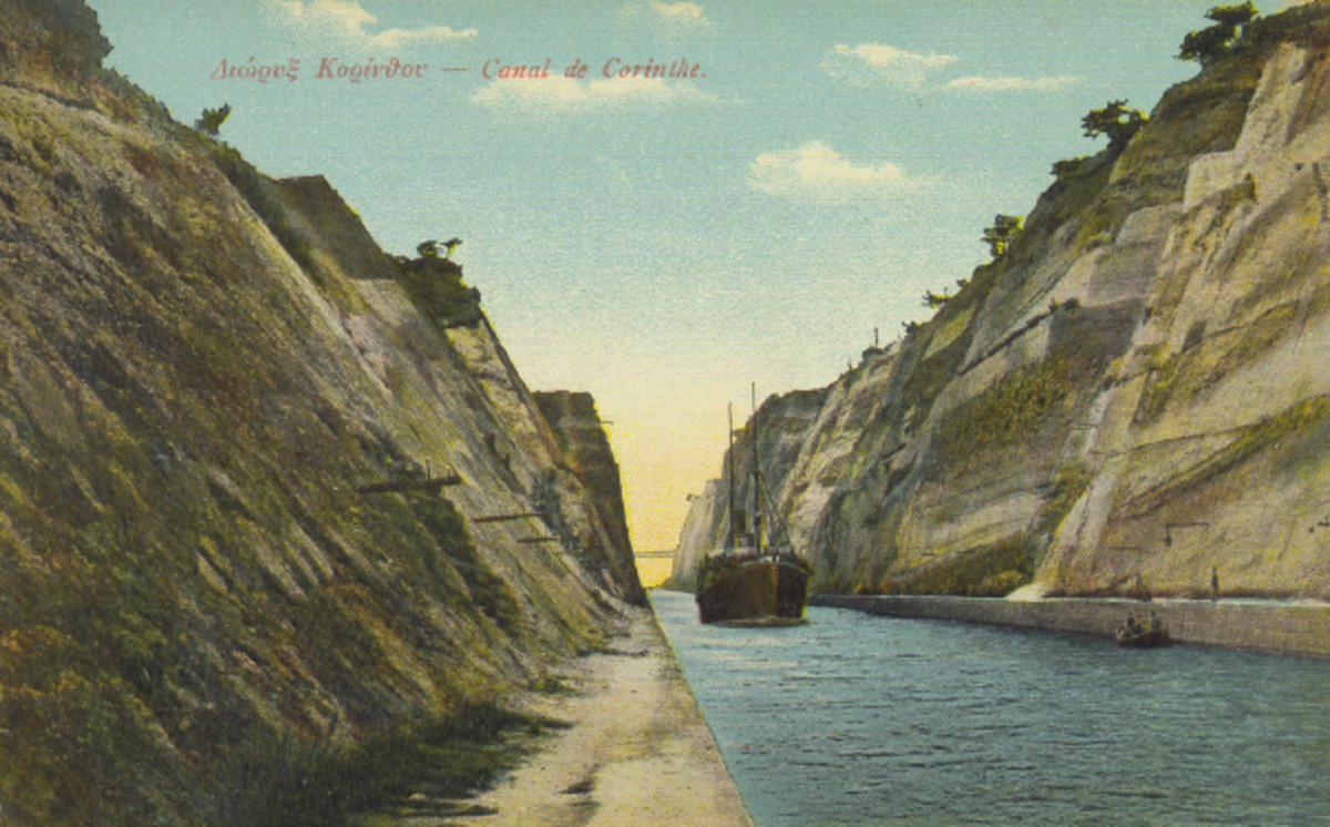 Corinth Canal in an old photo postcard.  This is one view, not quite as spectacular as from up above, but unique as it is hard to get to see from this view.