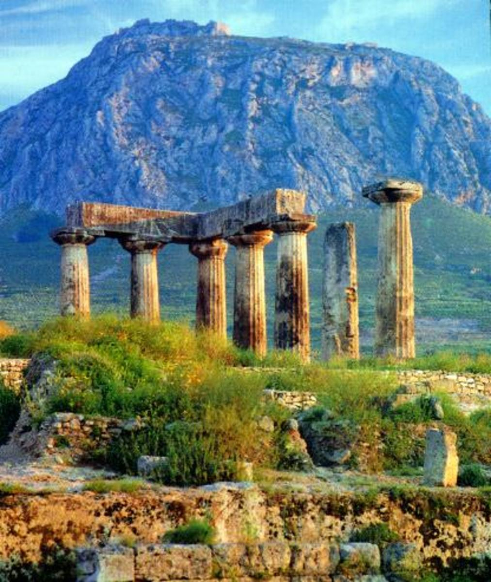 Temple of Apollo, in Corinth with Acro corinth on the mountain in the background.