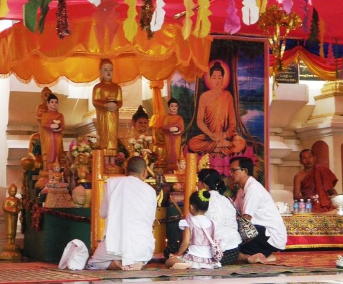 Cambodian Family Praying in the Monastery